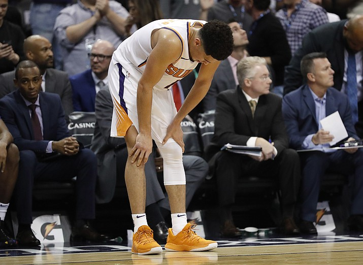 Phoenix Suns guard Devin Booker looks at the floor as time expires during the second half of the team's NBA basketball game against the Boston Celtics, Thursday, Nov. 8, 2018, in Phoenix. The Celtics won 116-109 in overtime. (Matt York/AP)