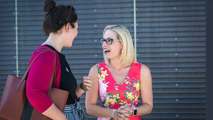 Democratic U.S. Senate candidate Kyrsten Sinema meets with a voter outside the Burton Barr Library in Phoenix Tuesday. (Kyrsten Sinema for Senate via Twitter)