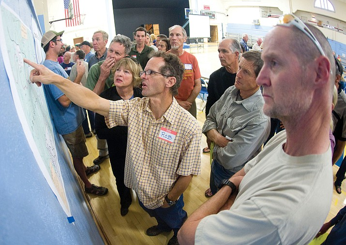 Rob Hehlen points out some of the proposed trails during a 2015 Greater Prescott Trails Planning meeting in Prescott. Trails in the area, including Seven Mile Gulch, have been in the planning process for years. (Les Stukenberg/Courier, file)