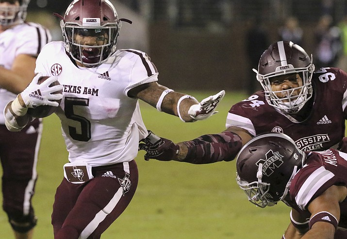 Texas A&M running back Trayveon Williams (5) stiff-arms Mississippi State safety Mark McLaurin (41) and defensive tackle Jeffery Simmons (94) during the second half of their NCAA college football game on Saturday, Oct. 27, 2018, in Starkville, Miss. MSU won 28-13. (Jim Lytle/AP)