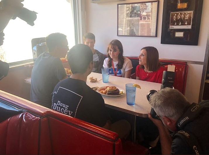 Republican U.S. Senate candidate Martha McSally sits with voters at Chase's Diner on Election Day, Tuesday, Nov. 6. (McSally for Senate via Twitter)