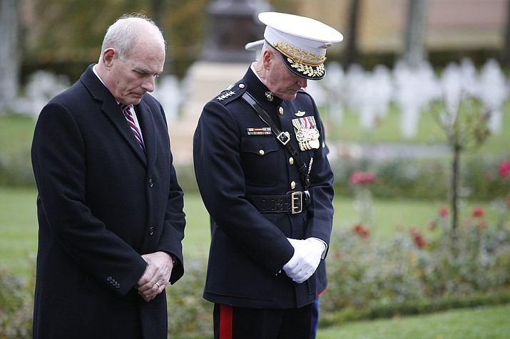 White House Chief of Staff John Kelly, left, and Chairman of the Joint Chiefs of Staff, Marine Gen. Joseph Dunford bow during for a ceremony at the Aisne Marne American Cemetery near the Belleau Wood battleground, in Belleau, France, Saturday, Nov. 10, 2018. Belleau Wood, 90 kilometers (55 miles) northeast of the capital, Iis the place where U.S. troops had their breakthrough battle by stopping a German push for Paris shortly after entering the war in 1917. (Francois Mori/AP)