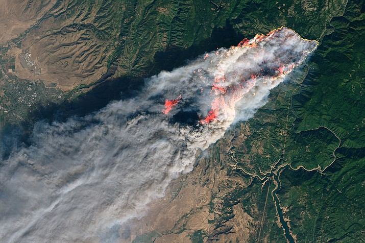 On the morning of November 8, 2018, the Camp Fire erupted 90 miles north of Sacramento, California. By evening, the fast-moving fire had charred around 18,000 acres and remained zero percent contained, according to news reports. The Operational Land Imager on Landsat 8 acquired this image on November 8, 2018, around 10:45 a.m. local time. The natural-color image was created using bands 4-3-2, along with shortwave infrared light to highlight the active fire. Officials are evacuating several towns, including Paradise. They have also closed several major highways. (NASA photo)