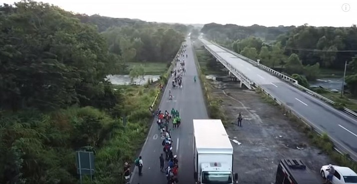 Thousands of Central American migrants were back on the move toward the U.S. border Saturday, after dedicated Mexico City metro trains whisked them to the outskirts of the capital and drivers began offering rides north. (Photo capture via AP video)