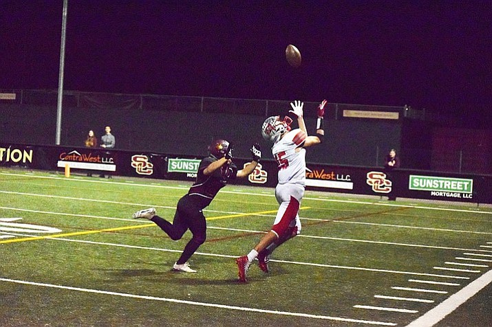 Mingus' Chaz Taylor catches a 29-yard pass. He would come down with a 15-yard touchdown reception to cap off the drive. (James Kelley, VVN/Courtesy)