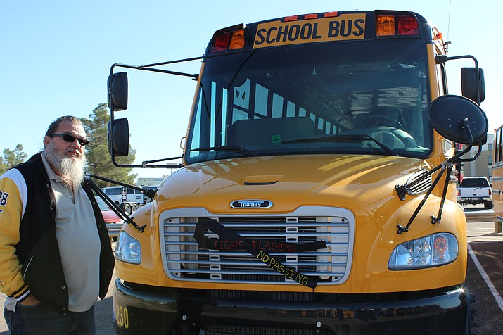 school bus drivers see cars avoid stop arm sign on a daily basis