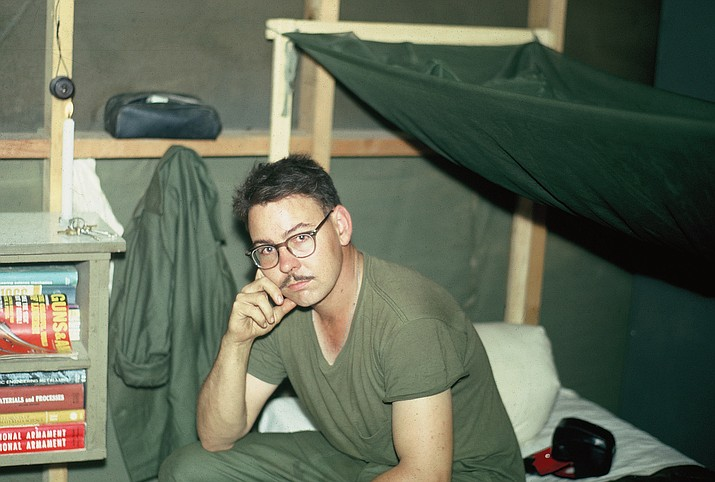 Keith Gilbert, sitting on his bunk in Vietnam around 1966-67, was hoping to be drafted by the U.S. Navy but ended up with the U.S. Corps of Engineers. (Courtesy photo)