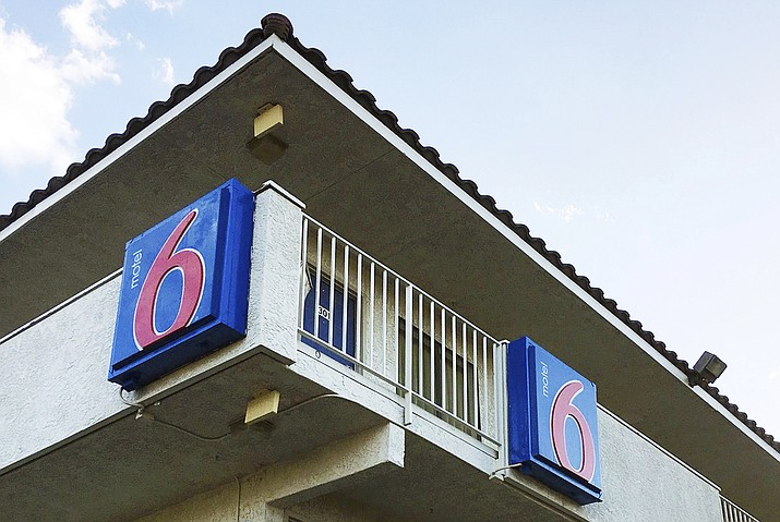 The Motel 6 chain has agreed in a proposed settlement to pay up to $7.6 million to guests who say the company's employees shared their private information with immigration officials. (Anita Snow/AP, File)
