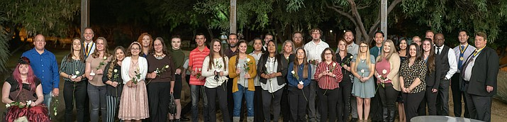 Back row, from left to right: Peter Roth (PTK Chapter Co-Advisor), Bethany Armao, Angelique Shumway (PTK Chapter Vice President of Leadership), Bronsten Bratley, Jay Schmidt, Maria Lancaster, Jesse Masters, Joshua Lennen, Timothy Wiechert,  Alex Chadsey (PTK Chapter President), Kyran Soriano, Dominique Mena (PTK Chapter Vice President of Fellowship), Levi Van Dyke, Jeremy Roth (PTK Chapter Co-Advisor), John Hansen (PTK Chapter Advisor). Front row, from left to right: Sterling Silverman, Bruce Lusk, Marissa Garza, Melissa Thornton, Tuesday Querio, Richelle Szafasz, Sky Sexton, Melisa Davis, Sienna Cobanovich, Danielle Bravo, Frances Edwards, Revae Crawford, Kathryn Hoover, Tamra Tate, Katelyn Berry, Veronica Azimi, Ariel Adamian (PTK Chapter Secretary), Elizabeth Najera (PTK Chapter Vice-President of Scholarship), Dr. Fred Gilbert (Kingman Campus Dean), Dr. John Kitts (PTK Chapter Co-Advisor). (Photo courtesy of MCC)