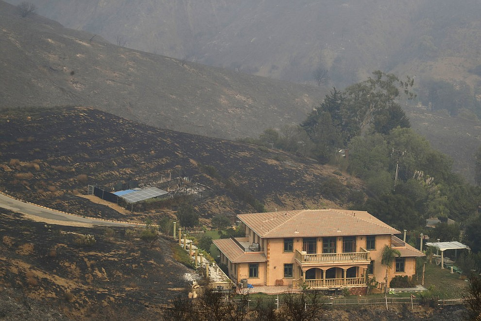 A home is spared after a wildfire swept through Saturday, Nov. 10, 2018, in Malibu, Calif. (AP Photo/Marcio Jose Sanchez)