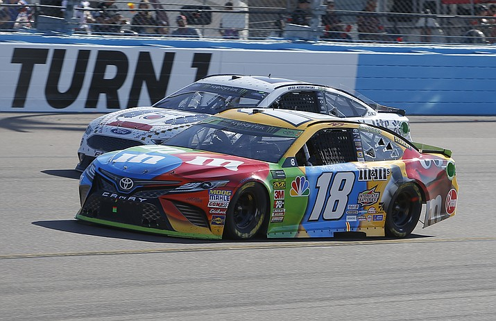Kyle Busch (18) leads Brad Keselowski (2) on lap 120 during a NASCAR Cup Series auto race on Sunday, Nov. 11, 2018, in Avondale. (Rick Scuteri/AP)