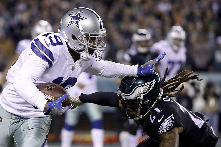 Dallas Cowboys wide receiver Amari Cooper runs with the ball as Philadelphia Eagles cornerback Ronald Darby moves in for the tackle during the first half Sunday, Nov. 11, 2018, in Philadelphia. (Matt Rourke/AP)