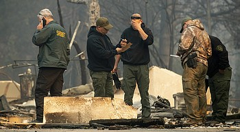 Hearses stand by as crews search for California fire victims photo