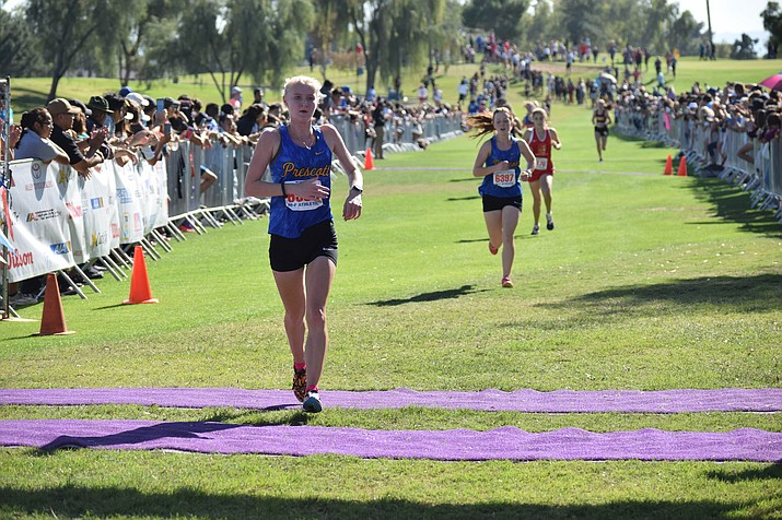 Prescott's Makenna Bray crosses the finish line seventh overall at the Division III Cross-Country State Championships on Saturday, Nov. 10, 2018, in Phoenix. The Prescott girls took second overall with 129 total team points. (James Kelley/VVN)