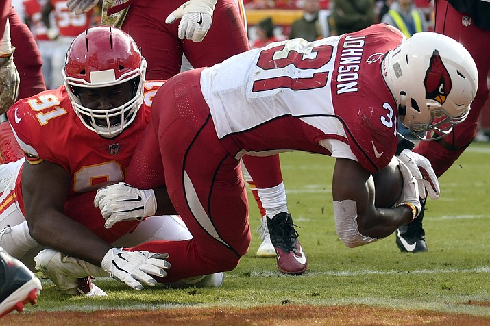 Arizona Cardinals running back David Johnson (31) scores a touchdown past Kansas City Chiefs defensive lineman Derrick Nnadi (91) during the second half of an NFL football game in Kansas City, Mo., Sunday, Nov. 11, 2018. (Ed Zurga/AP)