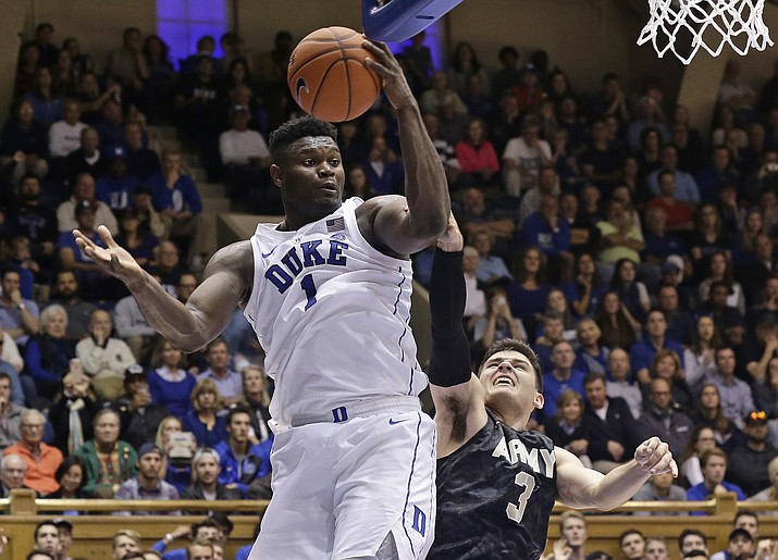 Duke's Zion Williamson (1) looks toward the basket while Army's Tommy Funk (3) defends during the second half of an NCAA college basketball game in Durham, N.C., Sunday, Nov. 11, 2018. (Gerry Broome/AP)
