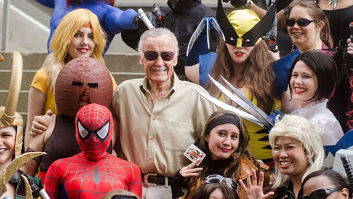 Stan Lee amongst fans dressed as assorted Marvel characters at DragonCon 2012. (Photo by Kyle Nishioka CC BY 2.0, via Wikimedia Commons)