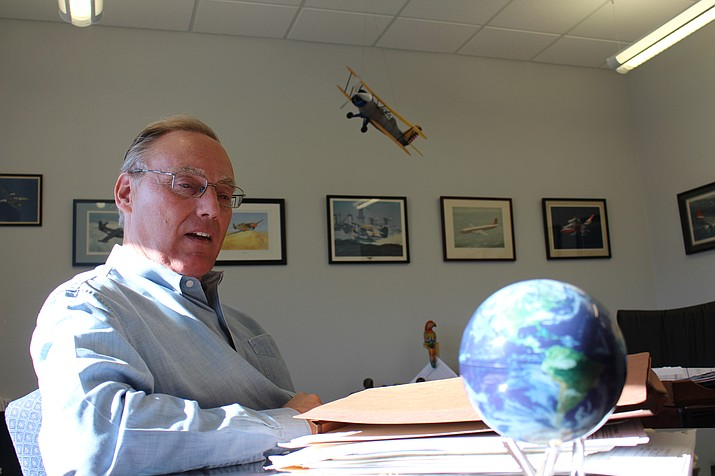 "Steve Johnston discusses his role as new general manager of Kingman Airport and Industrial Park in his office Thursday. He said the airport has ""unrealized potential."" (Photo by Hubble Ray Smith/Daily Miner)"
