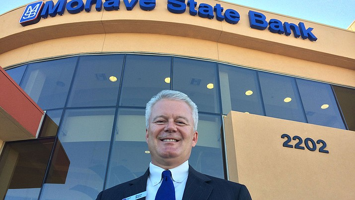 In this file photo, Mohave State Bank CEO Brian Riley stands in front of the bank's branch on Hualapai Mountain Road. (Daily Miner file photo)