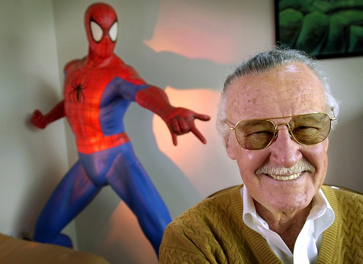"""Stan Lee, 79, creator of comic-book franchises such as """"Spider-Man,"""" """"The Incredible Hulk"""" and """"X-Men,"""" smiles during a photo session April 16, 2002, in his office in Santa Monica, Calif. Comic book genius Lee, the architect of the contemporary comic book, has died. He was 95. (Reed Saxon/AP, File)"""