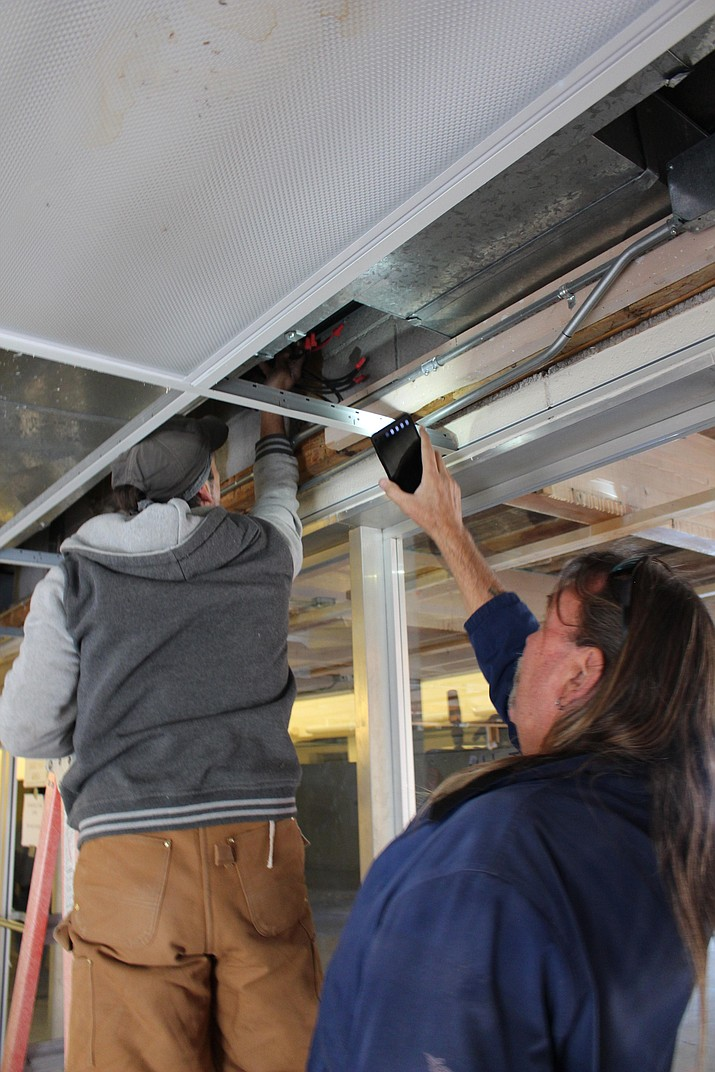 Workers check the wiring for the air conditioning system Tuesday at Arnold Plaza, which is being rehabilitated into a resource center for homeless veterans. (Photo by Hubble Ray Smith/Daily Miner)