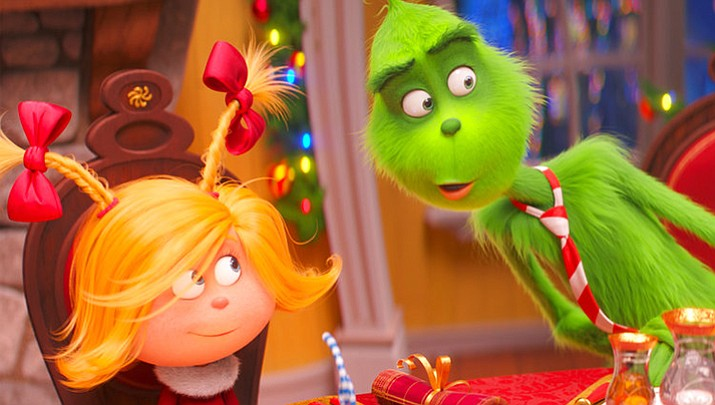 "This file image released by Universal Pictures shows the characters Cindy-Lou Who, voiced by Cameron Seely, left, and Grinch, voiced by Benedict Cumberbatch, in a scene from ""The Grinch."" ""Dr. Seuss' The Grinch"" made off with $66 million for Universal Pictures to top the weekend North American box office, according to studio estimates Sunday, Nov 11, 2018. (Universal Pictures via AP, File)"