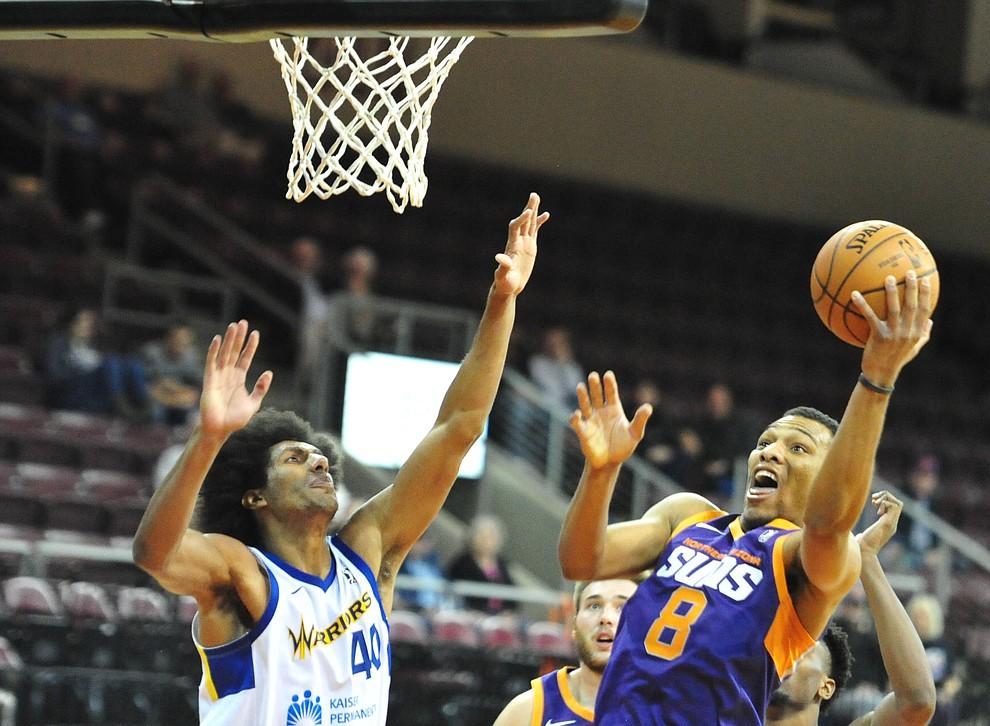 Northern Arizona's George King sends up an off-balance shot as the Suns play the Santa Cruz Warriors  Tuesday, Nov. 13, 2018 at the Prescott Valley Event Center.  (Les Stukenberg/Courier).