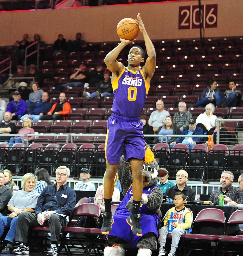 Northern Arizona's Daniel Dixon sends up a three-pointer as the Suns play the Santa Cruz Warriors  Tuesday, Nov. 13, 2018 at the Prescott Valley Event Center.  (Les Stukenberg/Courier).