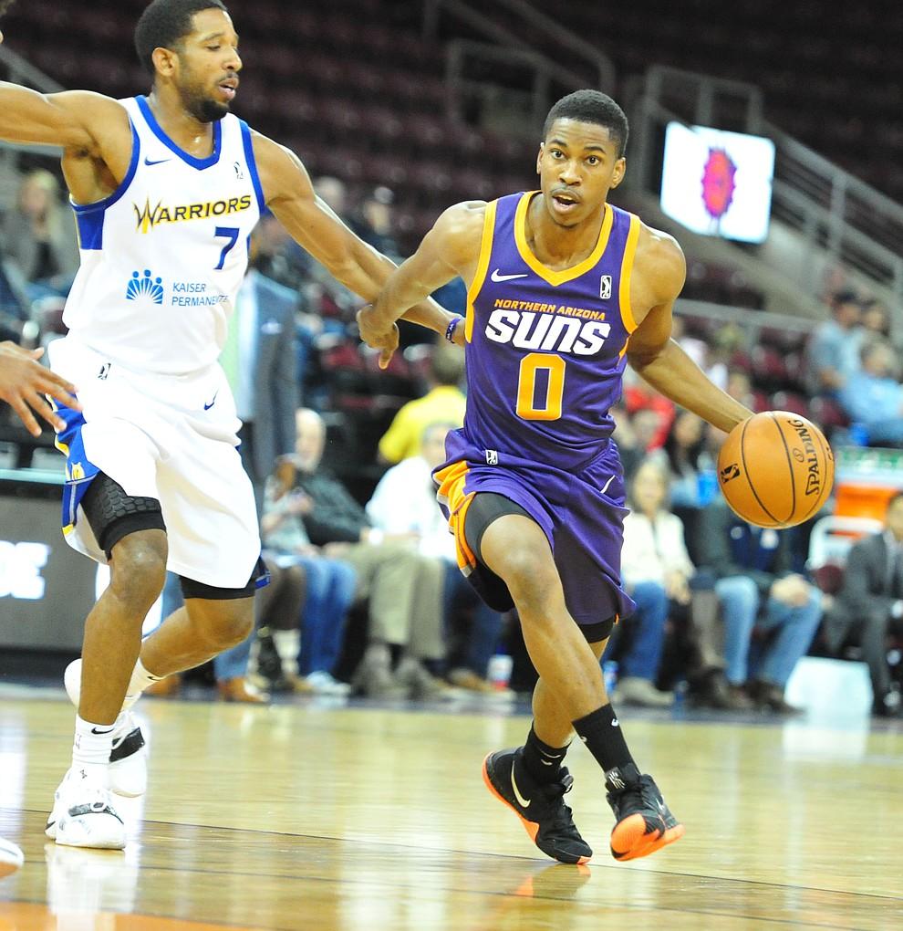 Northern Arizona's Daniel Dixon dribbles as the Suns play the Santa Cruz Warriors  Tuesday, Nov. 13, 2018 at the Prescott Valley Event Center.  (Les Stukenberg/Courier).