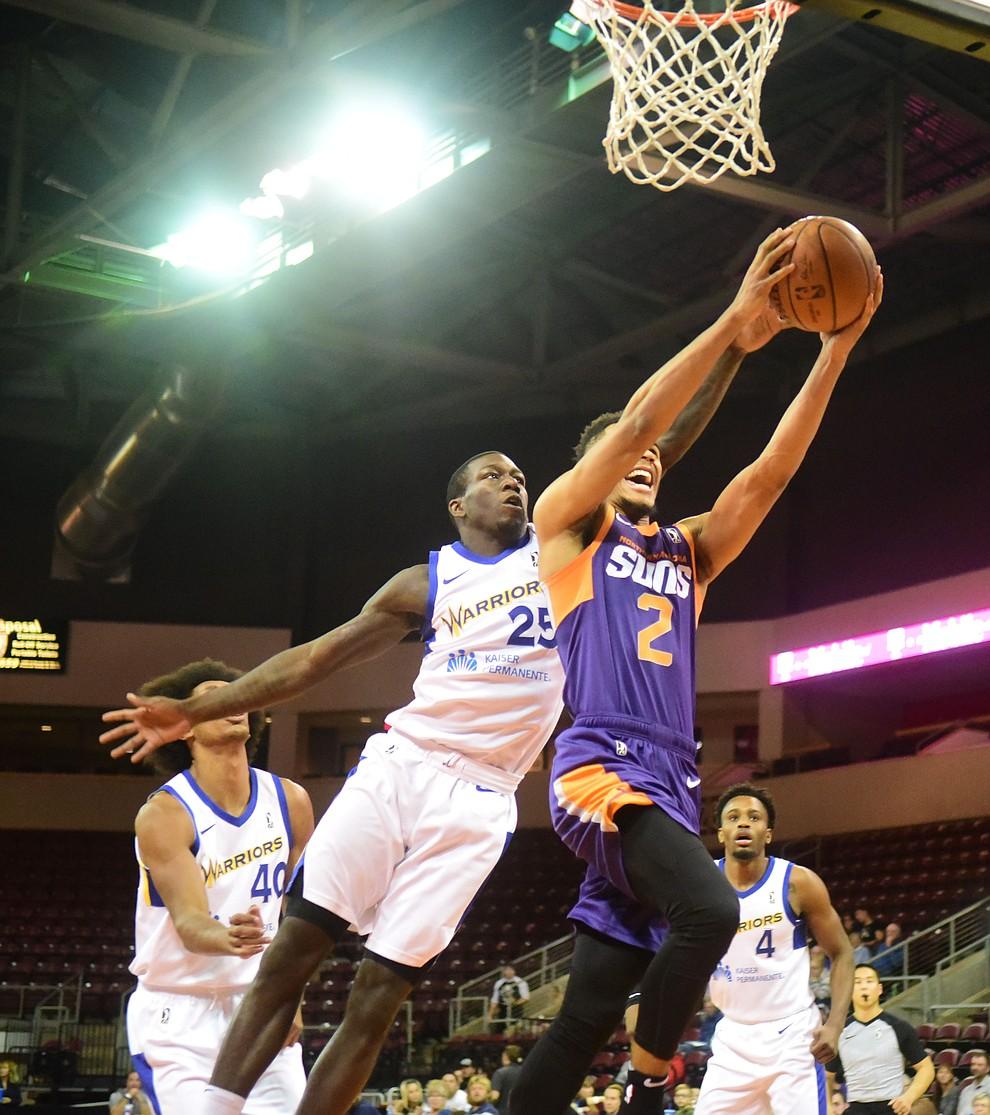 Northern Arizona's Elie Okobo goes tom the basket as the Suns play the Santa Cruz Warriors  Tuesday, Nov. 13, 2018 at the Prescott Valley Event Center.  (Les Stukenberg/Courier).
