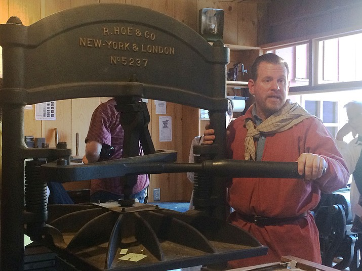 Troy Groves stands with the Washington Iron Hand Press in Sharlot Hall Museum's print shop. (Jason Wheeler/Courier)