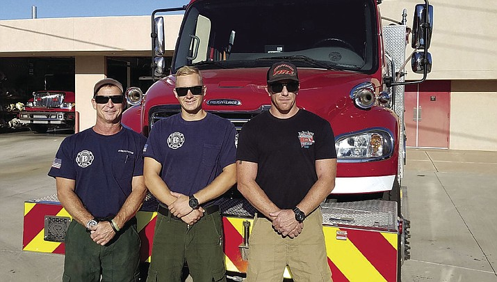 From left, Buckskin firefighter Todd Honomichl, firefighter Tyler Kowalski and Lt. Jason Weatherford pose for a photo before their deployment to assist with California wildfires this month. (Courtesy photo)