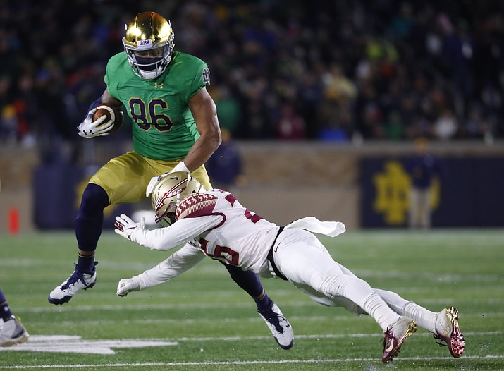 Notre Dame tight end Alize Mack (86) tries to avoid Florida State defensive back Asante Samuel Jr. (26) after a catch in the second half of an NCAA college football game in South Bend, Ind., Saturday, Nov. 10, 2018. (Paul Sancya/AP, file)