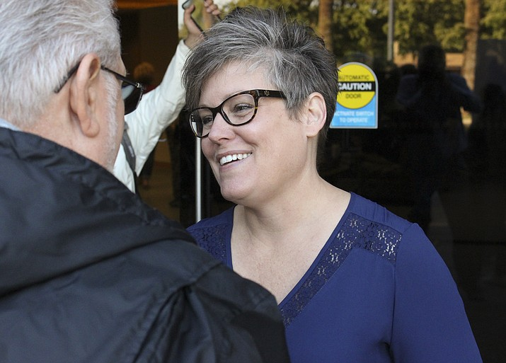 Arizona secretary of state candidate Katie Hobbs, right, chats with a supporter at a get-out-the vote event at the Arizona Education Association headquarters in Phoenix Saturday, Nov. 3, 2018. (Bob Christie/AP, file)