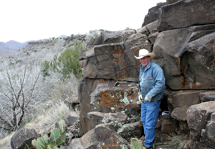 Kevin Leonard poses in February 2010 at the petroglyphs at Perry Mesa, one of the places he would take people to see. (Sue Tone/Tribune file)