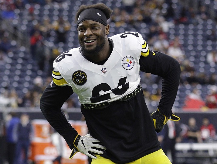 In this Dec. 25, 2017, file photo, Pittsburgh Steelers running back Le'Veon Bell (26) warms up before a game against the Houston Texans, in Houston. The Le'Veon Bell refused to sign a franchise tag by Tuesday, Nov. 13, 2018, and is out for the season. (Michael Wyke/AP, fIle)