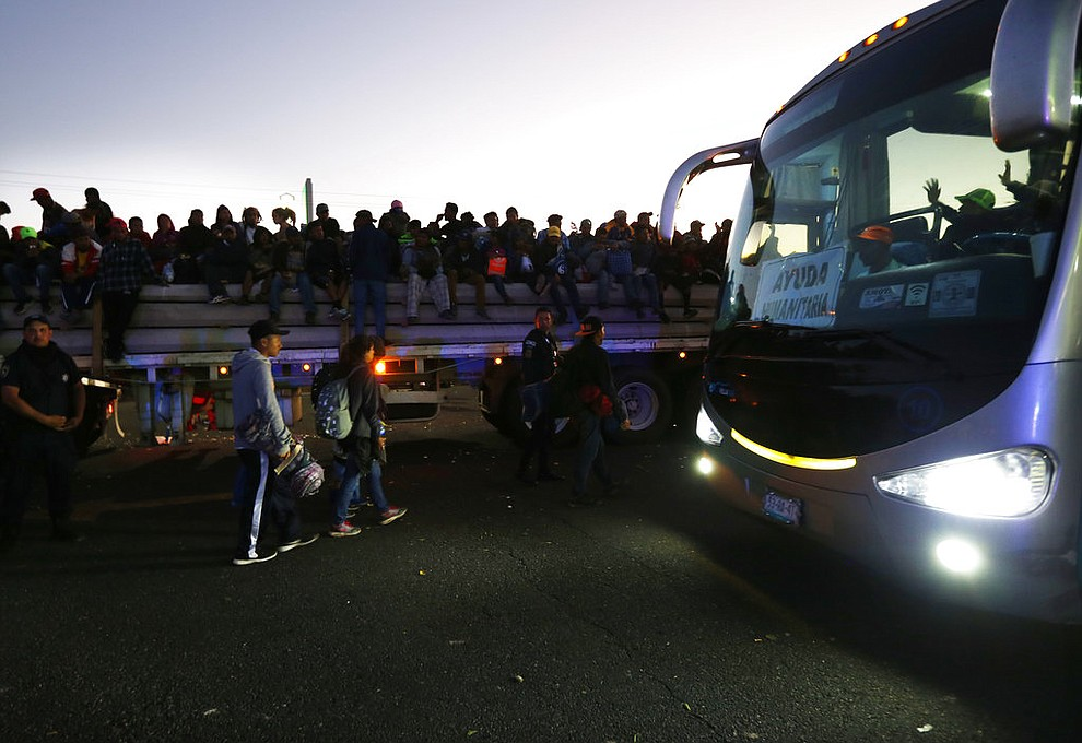 """Central American migrants get a ride on a bus provided by a group of humanitarian aid, in Ixtlán del Rio, Nayarit, Mexico, Tuesday, Nov. 13, 2018. The U.S. government said it was starting work Tuesday to """"harden"""" the border crossing from Tijuana, Mexico, to prepare for the arrival of a migrant caravan leapfrogging its way across western Mexico. (AP Photo/Marco Ugarte)"""