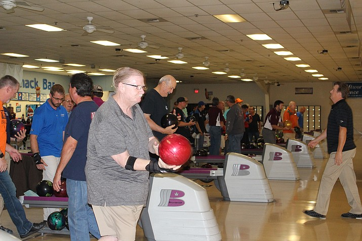 Kevin Grant Sr. gets ready to roll in the Tuesday night men's league at Cerbat Lanes, where some 300 bowlers participate each week in various leagues. (Photo by Hubble Ray Smith/Daily Miner)