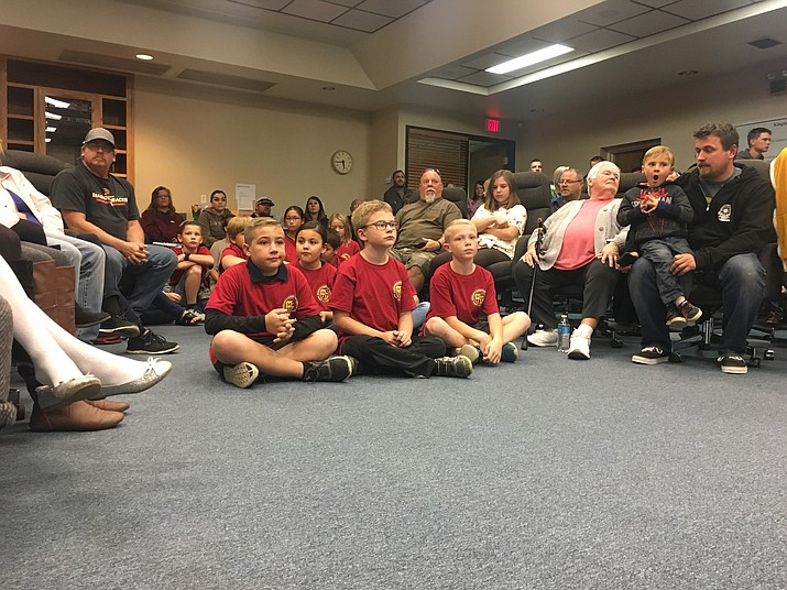 Students from Manzanita Elementary, who were being recognized for their AZMerit test results, wore matching shirts with their names on the back. Students from other schools in the district were also recognized for their hard work. (Photo by Vanessa Espinoza/Daily Miner)