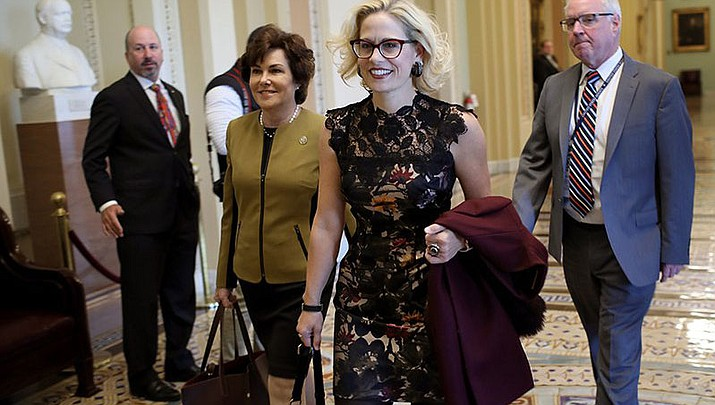 Newly elected Democratic senators Jacky Rosen of Nevada (left) and Kyrsten Sinema of Arizona head to a meeting Tuesday with Senate Minority Leader Chuck Schumer at the Capitol. The two will replace Republican senators when they are sworn in to the next Congress in January. (Photo by Win McNamee/Getty Images)