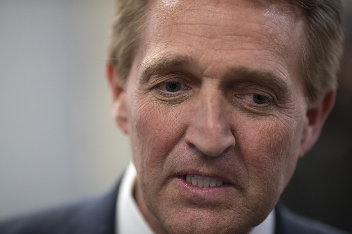 Sen. Jeff Flake, R-Ariz., speaks with reporters before he and Sen. Chris Coons, D-Del., try to bring up the legislation to protect special counsel Robert Mueller, at the Capitol in Washington, Wednesday, Nov. 14, 2018. (J. Scott Applewhite/AP)