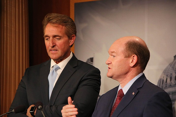 Sens. Jeff Flake, R-Arizona, left, and Chris Coons, D-Delaware, called for a vote on a bill that would protect Special Counsel Robert Mueller's probe of possible Russian meddling in the 2016 elections.  (Photo by Vandana Ravikumar/Cronkite News)
