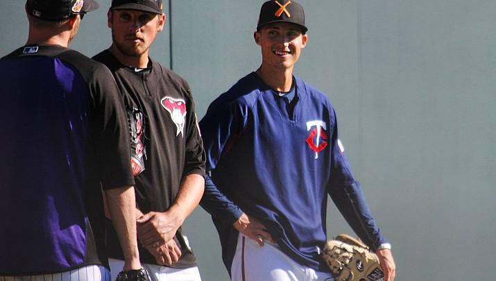 Arizona Fall League's Griffin Jax wears two uniforms
