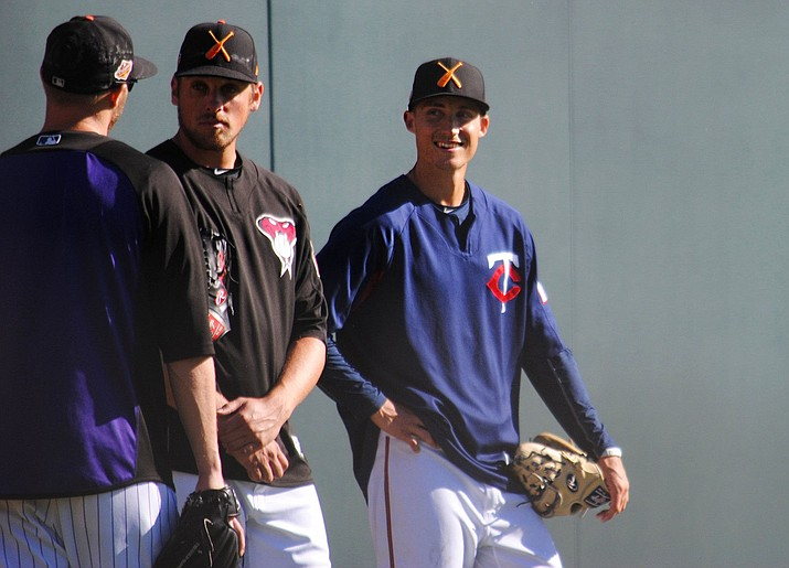 Griffin Jax, a pitcher in the Minnesota Twins organization, chats with teammates before an Arizona Fall League game. Jax also is on active duty as an Air Force officer. (Photo by Jake Trybulski/Cronkite News)