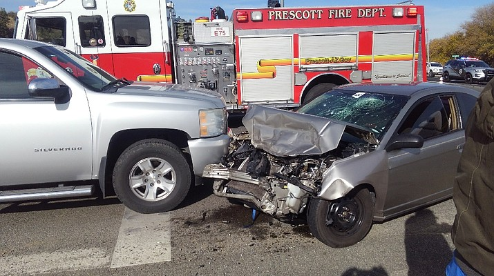 Distracted driver collides with truck on Highway 69