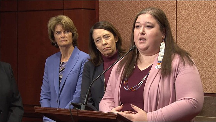Annita Lucchesi speaks about the report she co-authored, Missing and Murdered Indigenous Women and Girls, as Sens. Lisa Murkowksi, R-Alaska, left, and Maria Cantwell, D-Washington, look on. (Photo by Lillian Donahue/Cronkite News)
