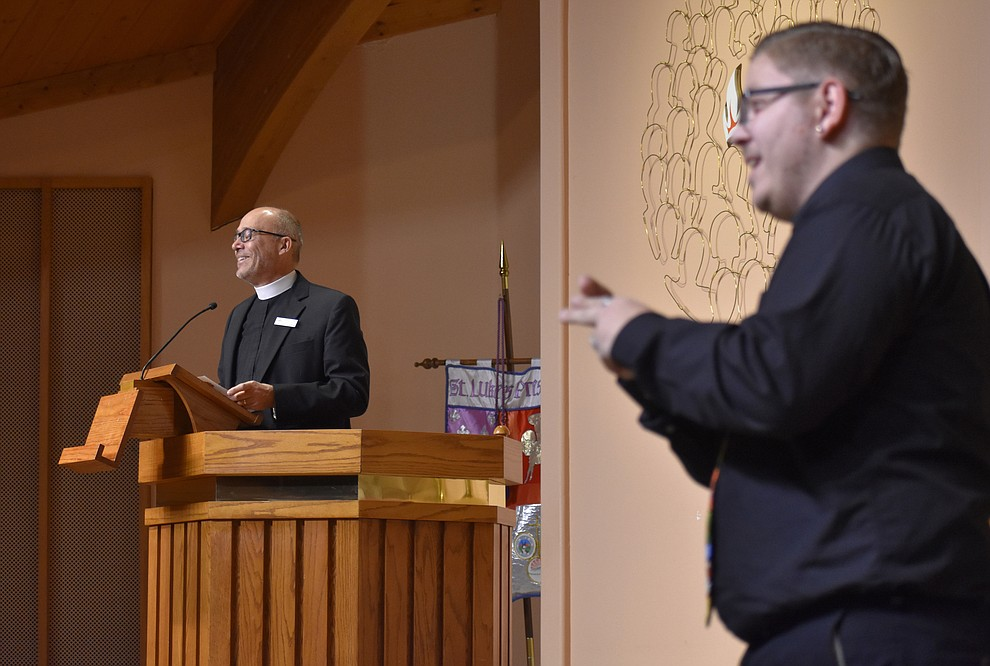 "Fr. Pierre-Henry Buisson welcomes the audience to the interfaith Celebration of Thanks concert on Nov. 15, 2018 at St. Luke's Episcopal Church in Prescott. The annual event, called ""Many Voices of Thanks,"" brings together choirs, musicians, dancers and speakers from many faith beliefs and is sponsored by the Quad City Interfaith Council. (Richard Haddad/WNI)"