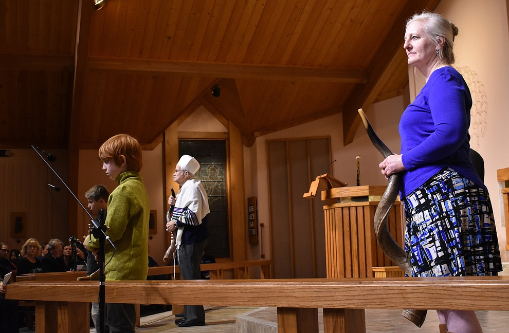 "Members of Prescott's Temple B'rith Shalom demonstrate the Blowing of the Shofars during the interfaith Celebration of Thanks concert on Nov. 15, 2018 at St. Luke's Episcopal Church in Prescott. The annual event, called ""Many Voices of Thanks,"" brings together choirs, musicians, dancers and speakers from many faith beliefs and is sponsored by the Quad City Interfaith Council. (Richard Haddad/WNI)"