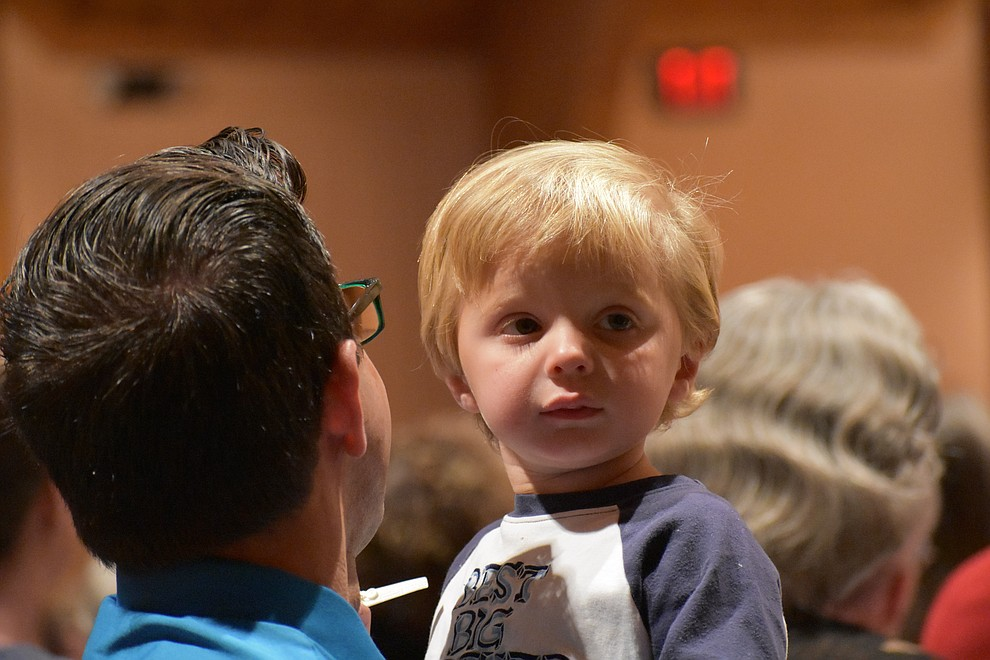 "A father and son sit in the audience during the 2018 Celebration of Thanks concert held Thursday, Nov. 15 at St. Luke's Episcopal Church in Prescott. The annual event, called ""Many Voices of Thanks,"" brings together choirs, musicians, dancers and speakers from many faith beliefs and is sponsored by the Quad City Interfaith Council. (Richard Haddad/WNI)"