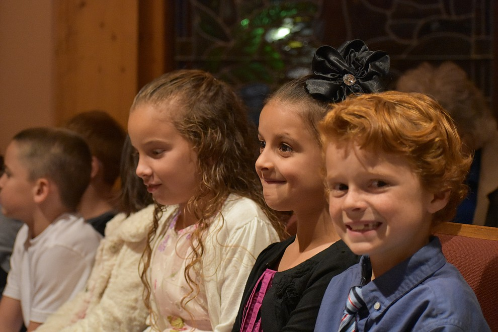 "Children sit in the audience during the 2018 Celebration of Thanks concert held Thursday, Nov. 15 at St. Luke's Episcopal Church in Prescott. The annual event, called ""Many Voices of Thanks,"" brings together choirs, musicians, dancers and speakers from many faith beliefs and is sponsored by the Quad City Interfaith Council. (Richard Haddad/WNI)"